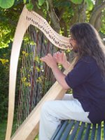 Chris playing harp in Brittany